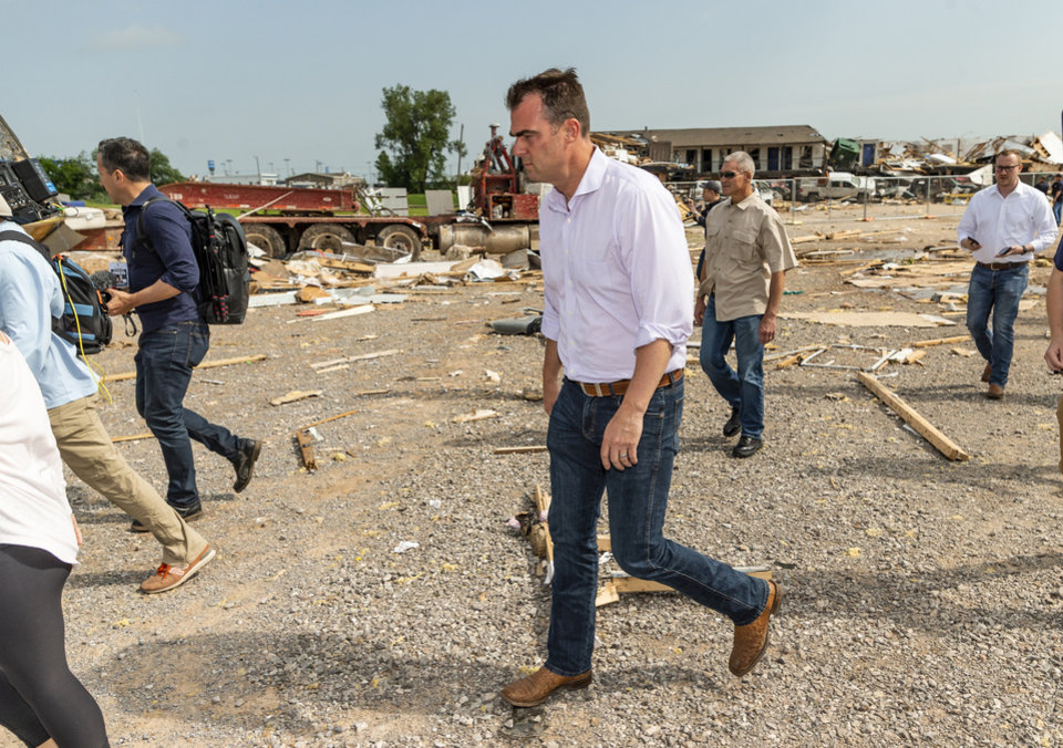 Photo - Gov. Kevin Stitt tours the aftermath of a tornado in El Reno, Okla. on Monday, May 27, 2019. The EF3 tornado hit the American Budget Value Inn and Skyview Mobile Home Park on Saturday night killing two people and injuring many others. [Chris Landsberger/The Oklahoman]