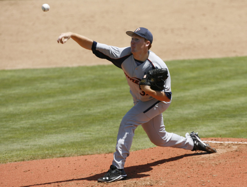 Photo - Pepperdine pitcher Corey Miller throws during the first inning against Arizona State in an NCAA college baseball tournament regional game Friday, May 30, 2014, in San Luis Obispo, Calif. (AP Photo/Aaron Lambert)