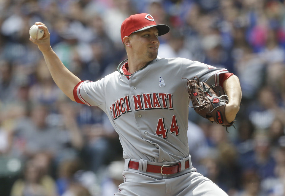 Photo - Cincinnati Reds starting pitcher Mike Leake throws to the Milwaukee Brewers during the first inning of a baseball game on Sunday, June 15, 2014, in Milwaukee. (AP Photo/Jeffrey Phelps)