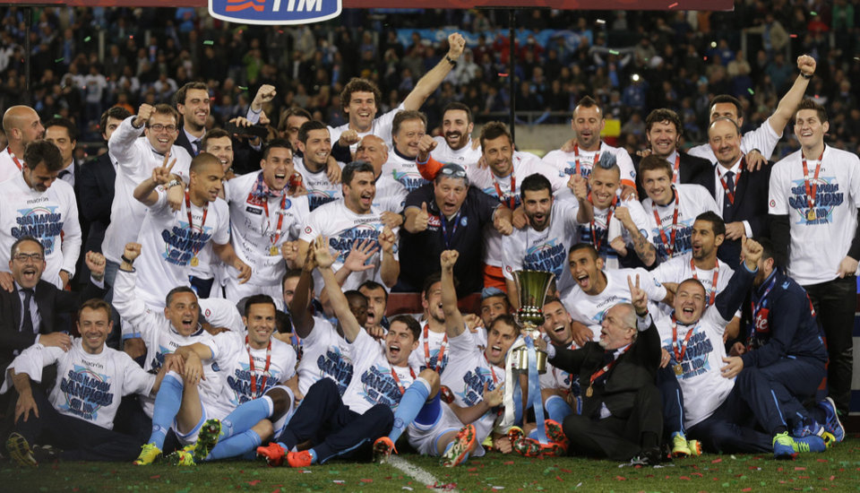 Photo - Napoli president Aurelio De Laurentiis lifts the trophy as he celebrates with his team after winning the Italian Cup final match between Fiorentina and Napoli in Rome's Olympic stadium Saturday, May 3, 2014. (AP Photo/Alessandra Tarantino)