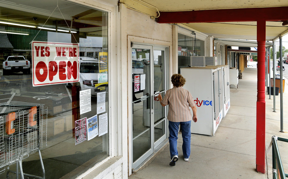 Photo - A customer enters Ron Chapdelaine's grocery store on Main Street in Canton  on Wednesday, May 21, 2014.   Photo by Jim Beckel, The Oklahoman