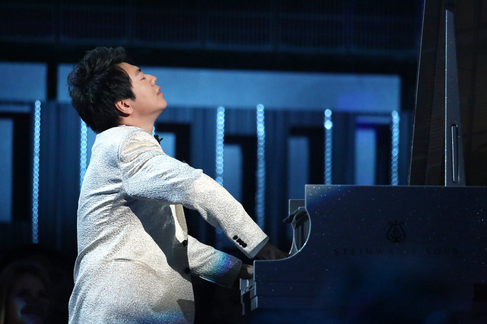 Photo - Lang Lang performs on stage at the 56th annual Grammy Awards at Staples Center on Sunday, Jan. 26, 2014, in Los Angeles. (Photo by Matt Sayles/Invision/AP)