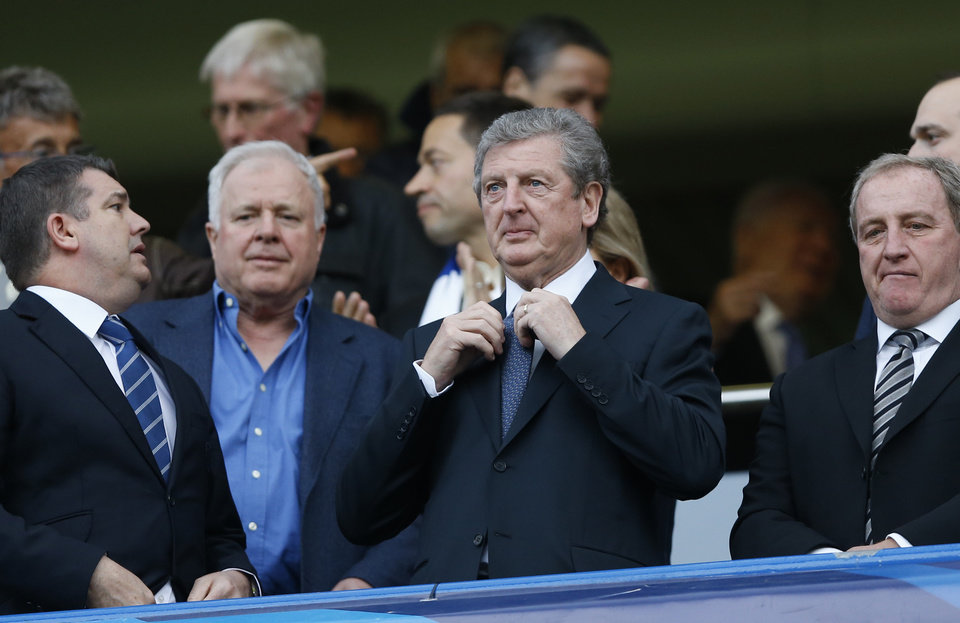 Photo - England's national team manager Roy Hodgson, centre waits for the start of a Champions League semifinal second leg soccer match between Chelsea and Atletico Madrid at Stamford Bridge Stadium in London Wednesday, April 30, 2014. (AP Photo/Kirsty Wigglesworth)