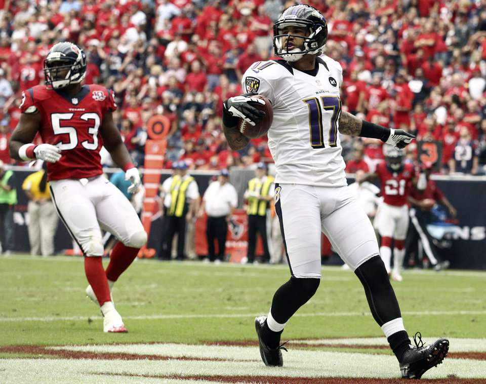 Photo -   Baltimore Ravens wide receiver Tandon Doss (17) scores a touchdown as Houston Texans' Bradie James (53) follows during the third quarter of an NFL football game, Sunday, Oct. 21, 2012, in Houston. (AP Photo/Patric Schneider)