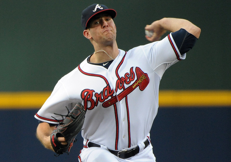 Photo - Atlanta Braves pitcher Alex Wood delivers to the Cleveland Indians during the first inning of a baseball game at Turner Field, Tuesday, Aug. 27, 2013, in Atlanta. (AP Photo/David Tulis)