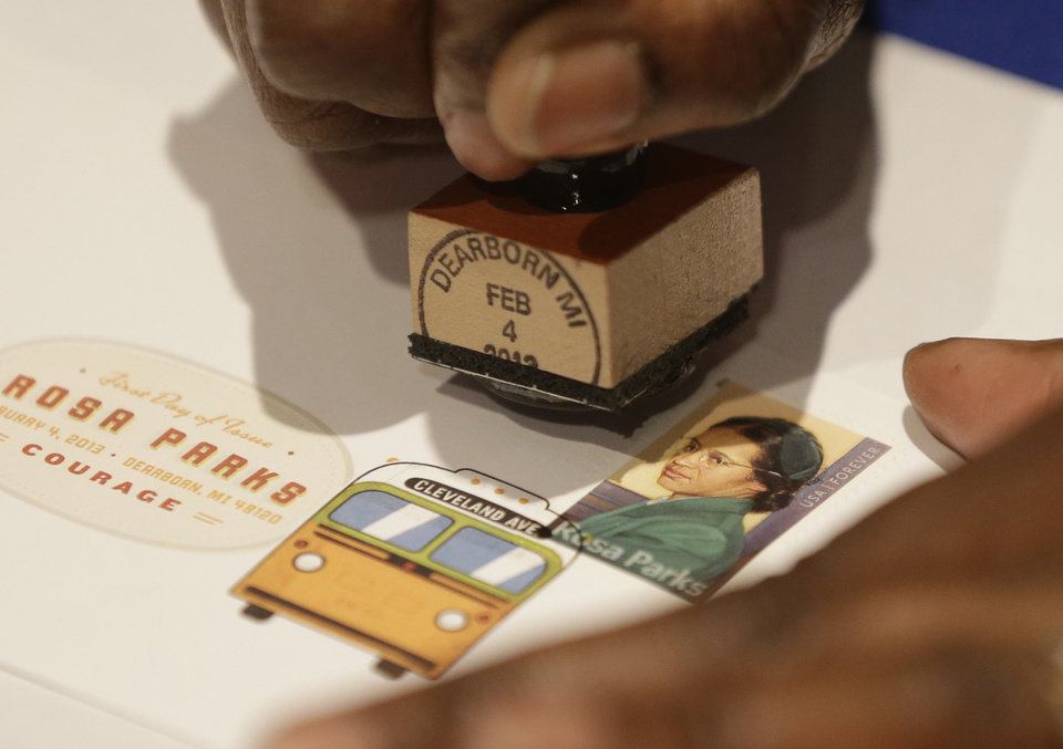 A postal service employee prepares to cancel the Rosa Parks' 100th birthday commemorative postage stamp at The Henry Ford museum in Dearborn, Mich., Monday, Feb. 4, 2013.   The museum held a 12-hour celebration of the 100th anniversary of Parks� birth.  (AP Photo/Carlos Osorio)