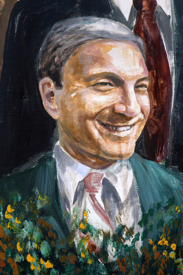 Photo -   A painting of former Penn State President Graham Spanier appears in a mural on a wall in downtown State College, Pa., by artists Michael Pilato and Yury Karabash, Thursday, July 12, 2012. After an eight-month inquiry, former FBI director Louis Freeh's firm produced a 267-page report that concluded that former Penn State head football coach Joe Paterno and other top Penn State officials, including Spanier, hushed up child sex abuse allegation against Jerry Sandusky more than a decade ago for fear of bad publicity, allowing Sandusky to prey on other youngsters. (AP Photo/Gene J. Puskar)
