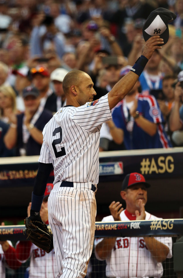 Photo - American League shortstop Derek Jeter, of the New York Yankees, waves as he is taken out of the game in the top of the fourth inning of the MLB All-Star baseball game, Tuesday, July 15, 2014, in Minneapolis. (AP Photo/Jim Mone)