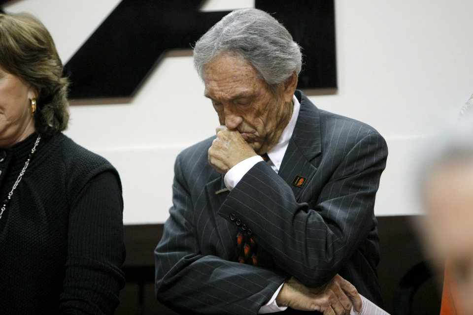 Eddie Sutton bows his head during a moment of silence  before  the basketball game between Oklahoma State and Texas, Wednesday, Jan. 26, 2011, at Gallagher-Iba Arena in Stillwater, Okla. Photo by Sarah Phipps, The Oklahoman
