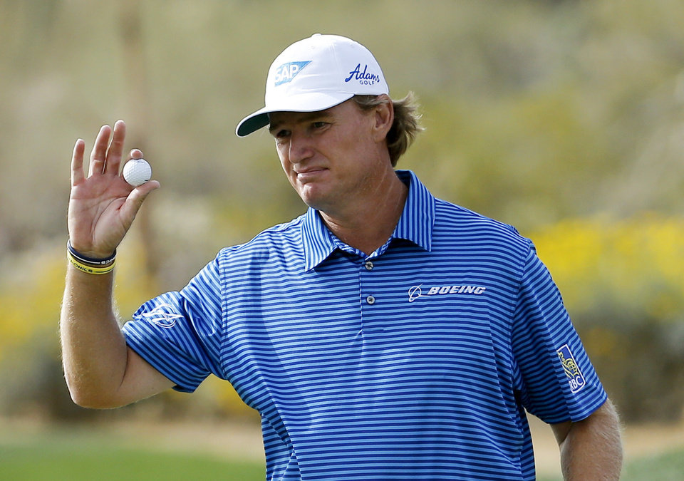 Photo - Ernie Els, of South Africa, waves after making a putt on the 15th hole in his match against Jordan Spieth during the fourth round of the Match Play Championship golf tournament on Saturday, Feb. 22, 2014, in Marana, Ariz. (AP Photo/Matt York)