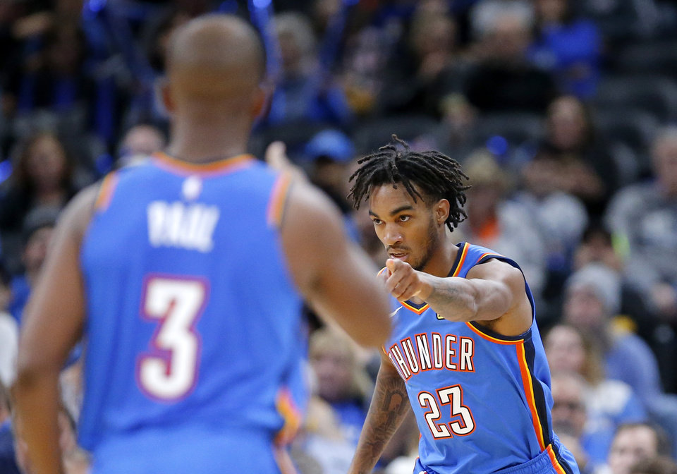 Photo - Oklahoma City's Terrance Ferguson (23) points to Chris Paul (3) after he hit a 3-point basket during the NBA game between the Oklahoma City Thunder and the Golden State Warriors at Chesapeake Energy Arena,   Saturday, Nov. 9, 2019.  [Sarah Phipps/The Oklahoman]