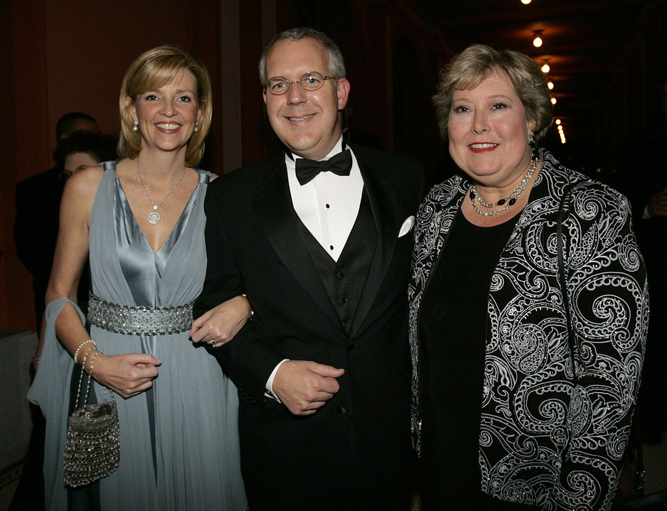 Photo - Oklahoma Gov. Brad Henry poses for a photo with his wife, Kim, left, and Oklahoma Lt. Gov. Jari Askins, right, at the Oklahoma Centennial Statehood Inaugural Ball, Saturday, Nov. 17, 2007, at the Guthrie Scottish Rite Masonic Center, in Guthrie, Okla. By Bill Waugh, The Oklahoman
