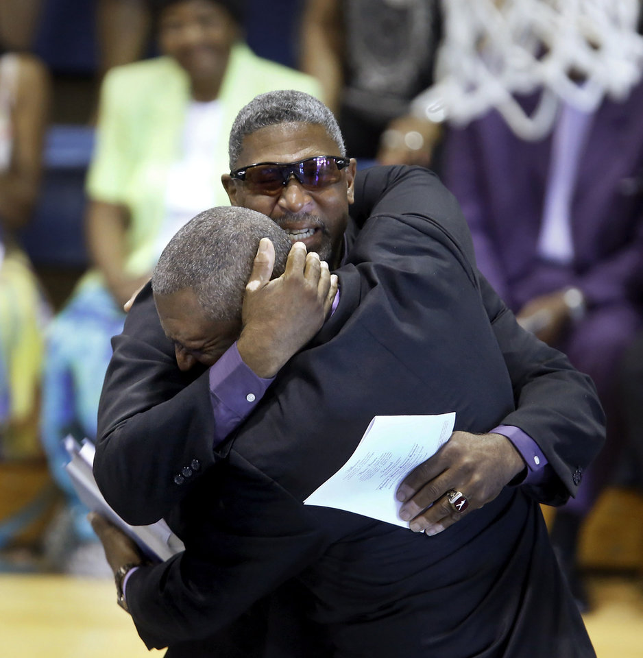 Larry Carter, right,  and his brother Fred, embrace after Fred delivered the eulogy for their father. About 400 family and friends gathered inside the Millwood High School Fieldhouse on  Tuesday,  Sep, 25, 2012, to honor the life and say farewell to Joseph D. Carter, Sr. at a funeral service that was sentimental and touching, but also full of joy and laughter. Carter is survived by a wife and their 11 children as well as 46 grandchildren, 35 great-grandchildren and 10 great-great-grandchildren. Photo by Jim Beckel, The Oklahoman.