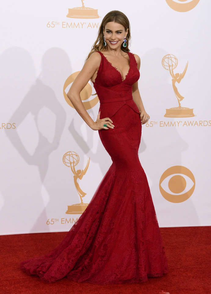 Sofia Vergara, wearing Vera Wang, poses backstage at the 65th Primetime Emmy Awards at Nokia Theatre on Sunday Sept. 22, 2013, in Los Angeles.  (Photo by Dan Steinberg/Invision/AP) ORG XMIT: CAAK137