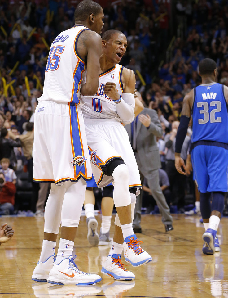 Photo - Oklahoma City's Russell Westbrook (0) and Kevin Durant (35) during an NBA basketball game between the Oklahoma City Thunder and the Dallas Mavericks at Chesapeake Energy Arena in Oklahoma City, Thursday, Dec. 27, 2012.  Oklahoma City won 111-105. Photo by Bryan Terry, The Oklahoman