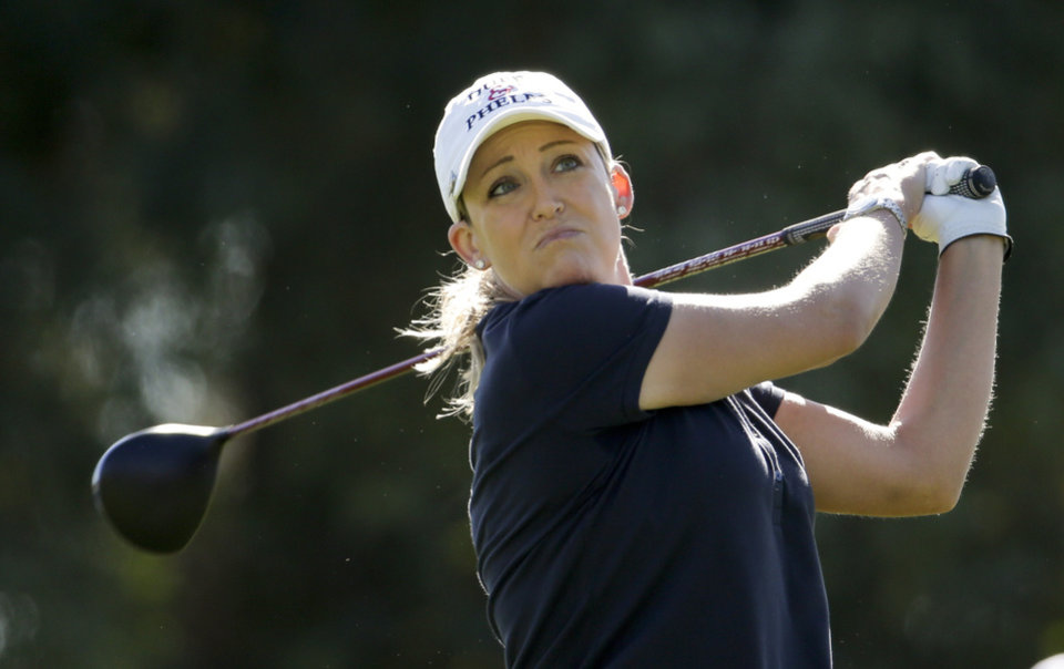 Photo - Cristie Kerr watches her tee shot on the 16th hole during the first round at the LPGA Kraft Nabisco Championship golf tournament Thursday, April 3, 2014 in Rancho Mirage, Calif. (AP Photo/Chris Carlson)