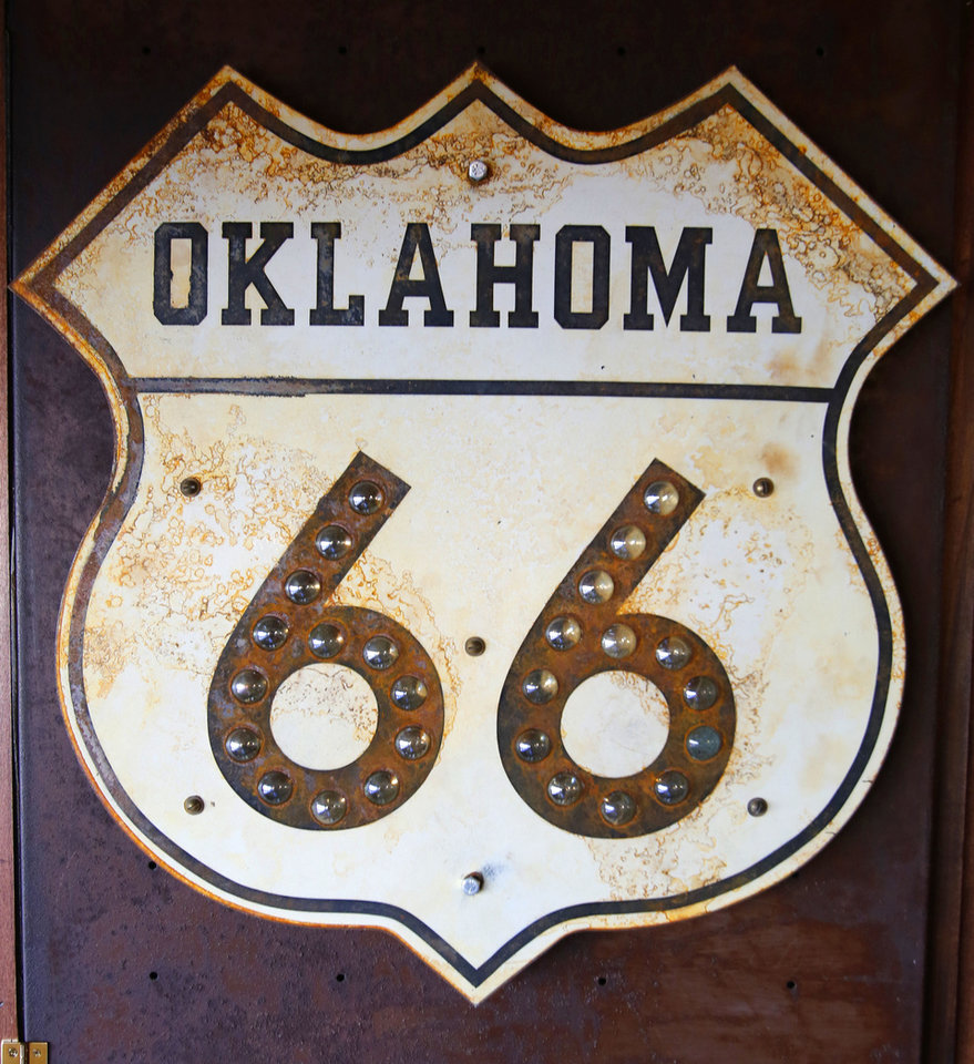 Photo - Route 66 sign hanging on the wall in the Green Chili Kitchen in Yukon, Friday  January  11, 2013. Photo By Steve Gooch, The Oklahoman