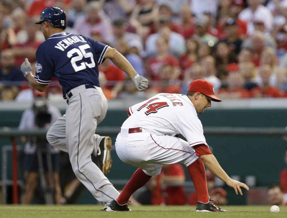 Photo - Cincinnati Reds starting pitcher Mike Leake (44) fields a ground ball hit by San Diego Padres' Will Venable (25) in the fifth inning of a baseball game, Tuesday, May 13, 2014, in Cincinnati. Leake threw Venable out at first. (AP Photo)