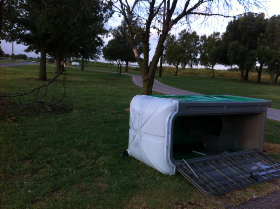 Tree limbs and a portable rest room are down on E Overholser Drive on the northeast side of Lake Overholser. Photo by Robert Medley