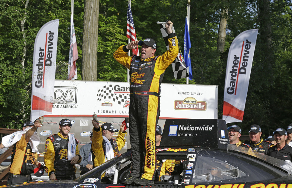 Photo - Brendan Gaughan celebrates after winning the NASCAR Nationwide series auto race at Road America in Elkhart Lake, Wi., Saturday, June, 21, 2014.  (AP Photo/Jeffrey Phelps)