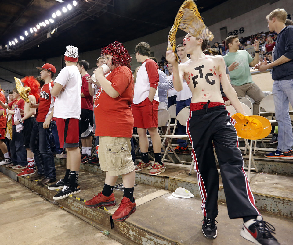 Fort Gibson fan Max Wicks dances in the stands during the state high school basketball tournament Class 4A girls championship game between Fort Gibson High School and Mount St. Mary High School at the State Fair Arena on Saturday, March 9, 2013, in Oklahoma City, Okla. Photo by Chris Landsberger, The Oklahoman