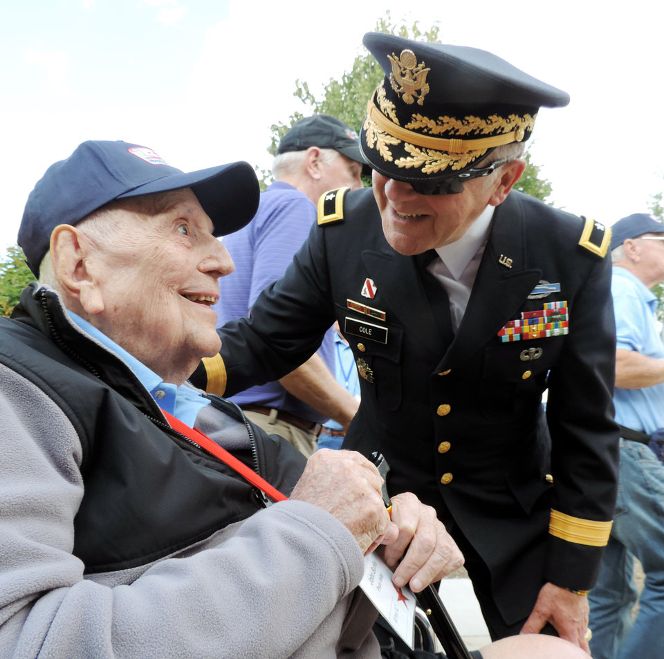 Photo - U.S. Army Ret. Brig. Gen David L. Cole (at World War II Memorial) greets U.S. Army Ret. Col. John R. Burks of Pauls Valley