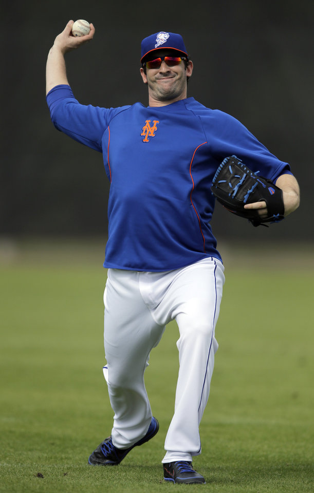 Photo - New York Mets pitcher Matt Harvey plays catch during spring training baseball practice Saturday, Feb. 22, 2014, in Port St. Lucie, Fla. Harvey underwent Tommy John surgery on Oct. 22. (AP Photo/Jeff Roberson)