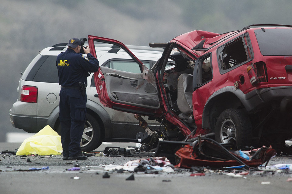 Photo - Officials investigate the scene of a multiple vehicle accident where 6 people were killed on the westbound Pomona Freeway in Diamond Bar, Calif. on Sunday morning, Feb. 9, 2013. Authorities say a wrong-way driver caused the pre-dawn crash that left six people dead.  (AP Photo/San Gabriel Valley Tribune,Watchara Phomicinda) MAGS OUT, NO SALES MANDATORY CREDIT