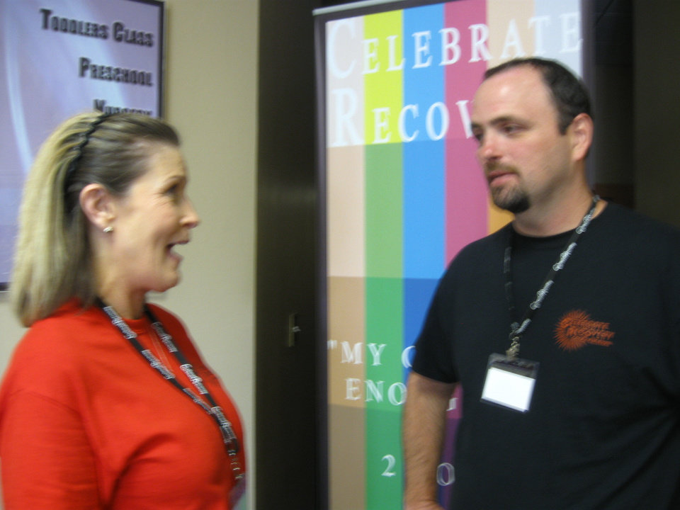 Photo - Fresh Start member Peggy Choate and the Rev. Dave Dooley talk at the recent Celebrate Recovery Inside One Day Seminar at Fresh Start Community Church in Moore.