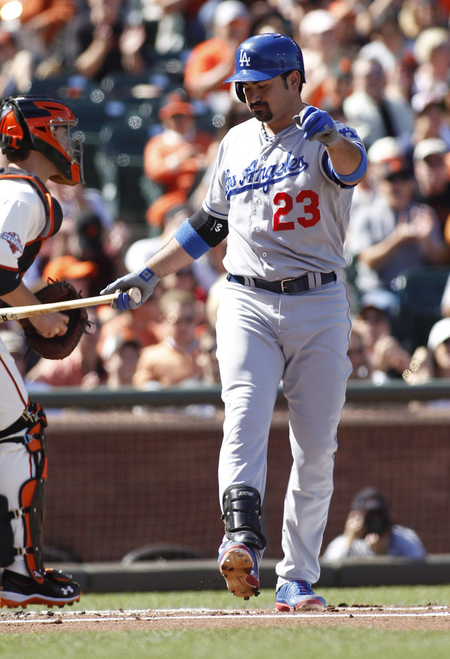 Photo - Los Angeles Dodgers' Adrian Gonzalez strikes out against the San Francisco Giants' during the first inning of a baseball game in San Francisco, Saturday, July 6, 2013. (AP Photo/George Nikitin)