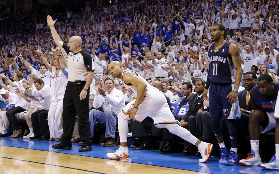 Oklahoma City's Derek Fisher looks upmafter making a three pointer as Memphis' Mike Conely watches during Game 2 in the second round of the NBA playoffs between the Oklahoma City Thunder and the Memphis Grizzlies at Chesapeake Energy Arena In Oklahoma City, Tuesday, May 7, 2013. Photo by Bryan Terry, The Oklahoman