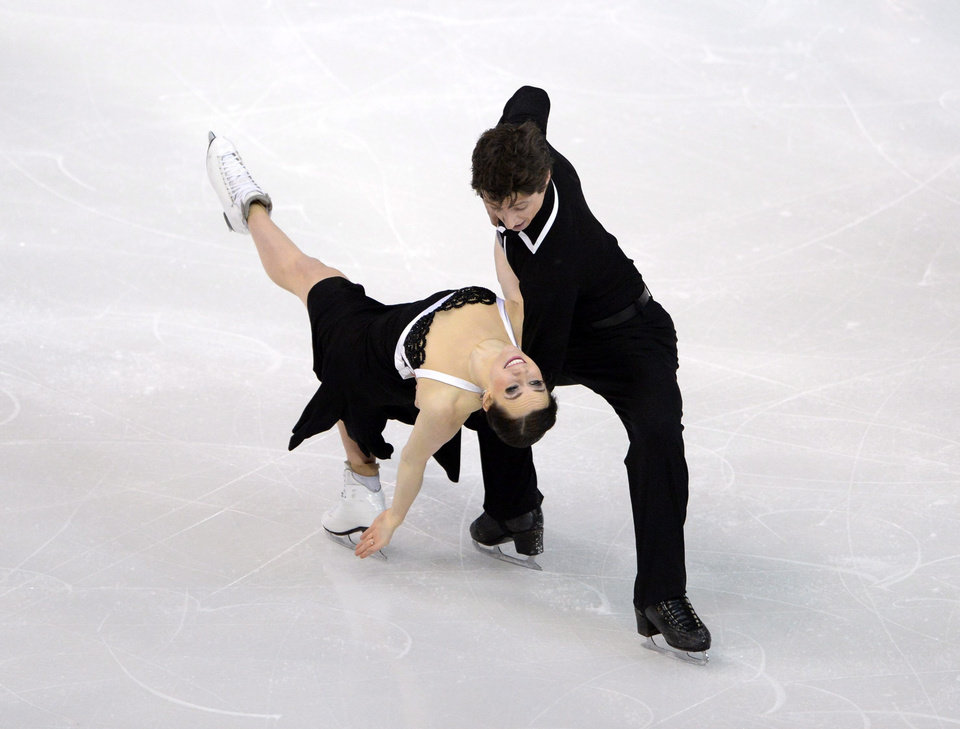 Photo - Tessa Virtue, bottom, and Scott Moir compete during the dance short program at the Canadian Figure Skating Championships, Friday, Jan. 10, 2014, in Ottawa, Ontario. (AP Photo/The Canadian Press, Sean Kilpatrick)