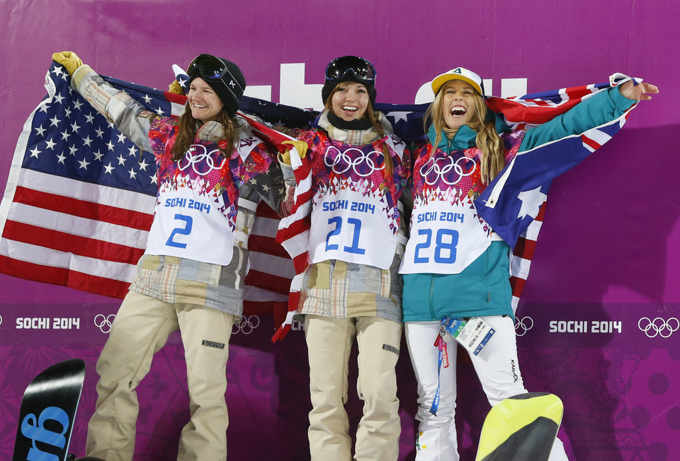 Photo - From left, bronze medalist United States' Kelly Clark, gold medalist United States' Kaitlyn Farrington and silver medalist Australia's Torah Bright pose following the women's snowboard halfpipe at the Rosa Khutor Extreme Park, at the 2014 Winter Olympics, Wednesday, Feb. 12, 2014, in Krasnaya Polyana, Russia.(AP Photo/Sergei Grits)