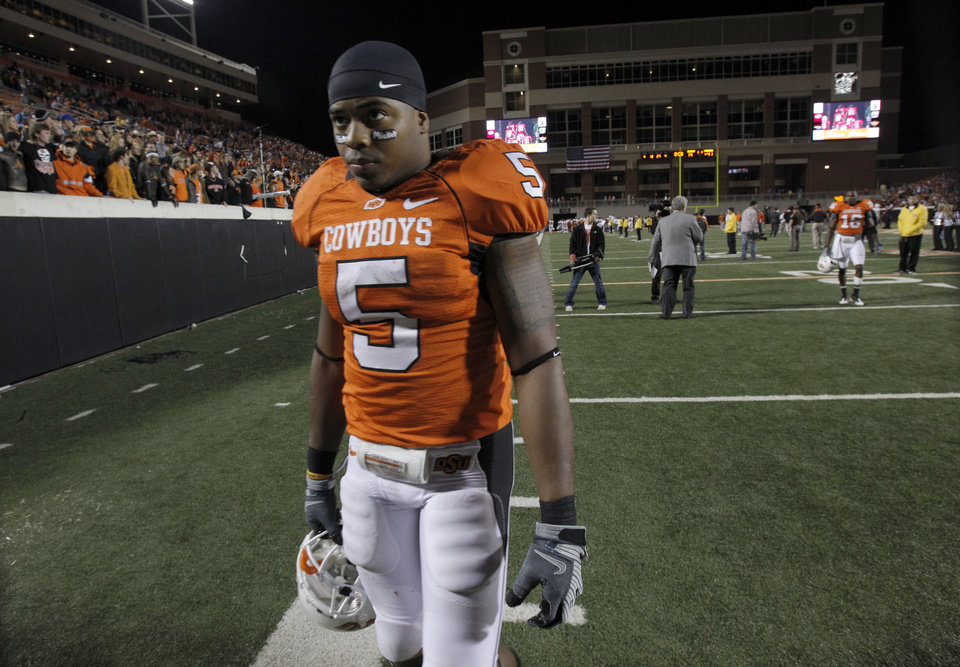 Photo - OSU's Keith Toston (5) walks off the field after the college football game between the Oklahoma State University Cowboys (OSU) and the University of Texas Longhorns (UT) at Boone Pickens Stadium in Stillwater, Okla., Saturday, Oct. 31, 2009. Photo by Sarah Phipps, The Oklahoman
