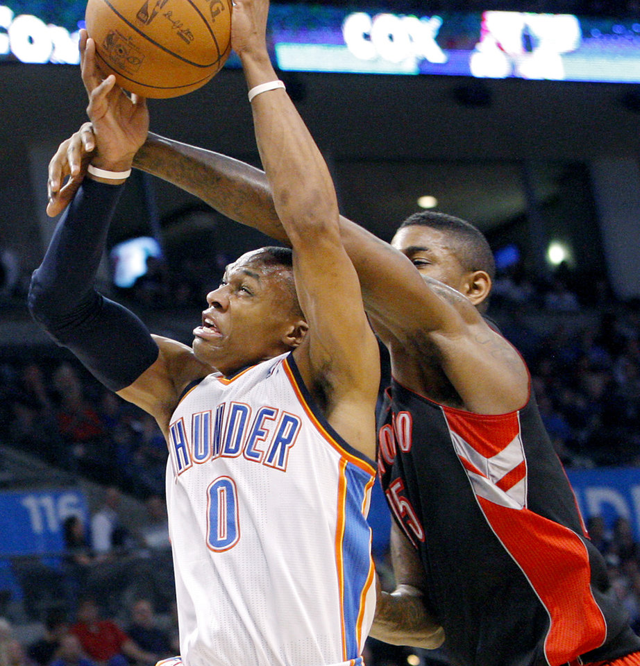 Photo - Oklahoma City's Russell Westbrook is fouled by Toronto's Amir Johnson during the second half of their NBA basketball game at the OKC Arena in downtown Oklahoma City on Sunday, March 20, 2011. The Raptors beat the Thunder 95-93. Photo by John Clanton, The Oklahoman