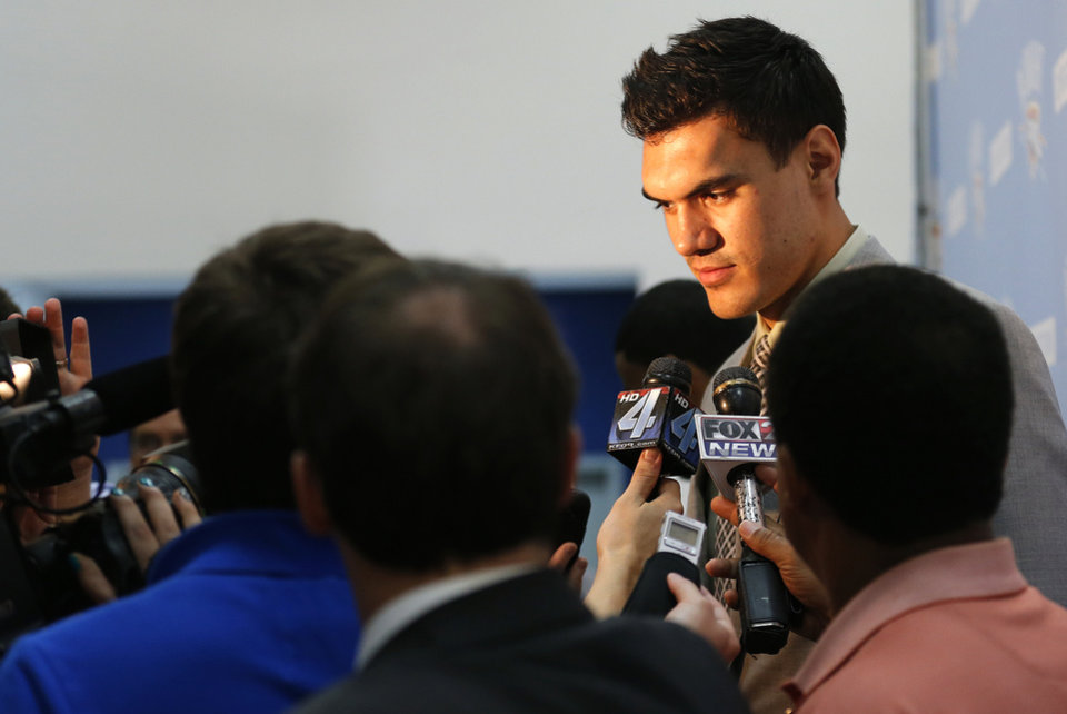 Photo - OKLAHOMA CITY THUNDER NBA BASKETBALL: Steven Adams talks to the media during a press conference at the Thunder Events center, Saturday, July 29, 2013. Photo by Sarah Phipps, The Oklahoman