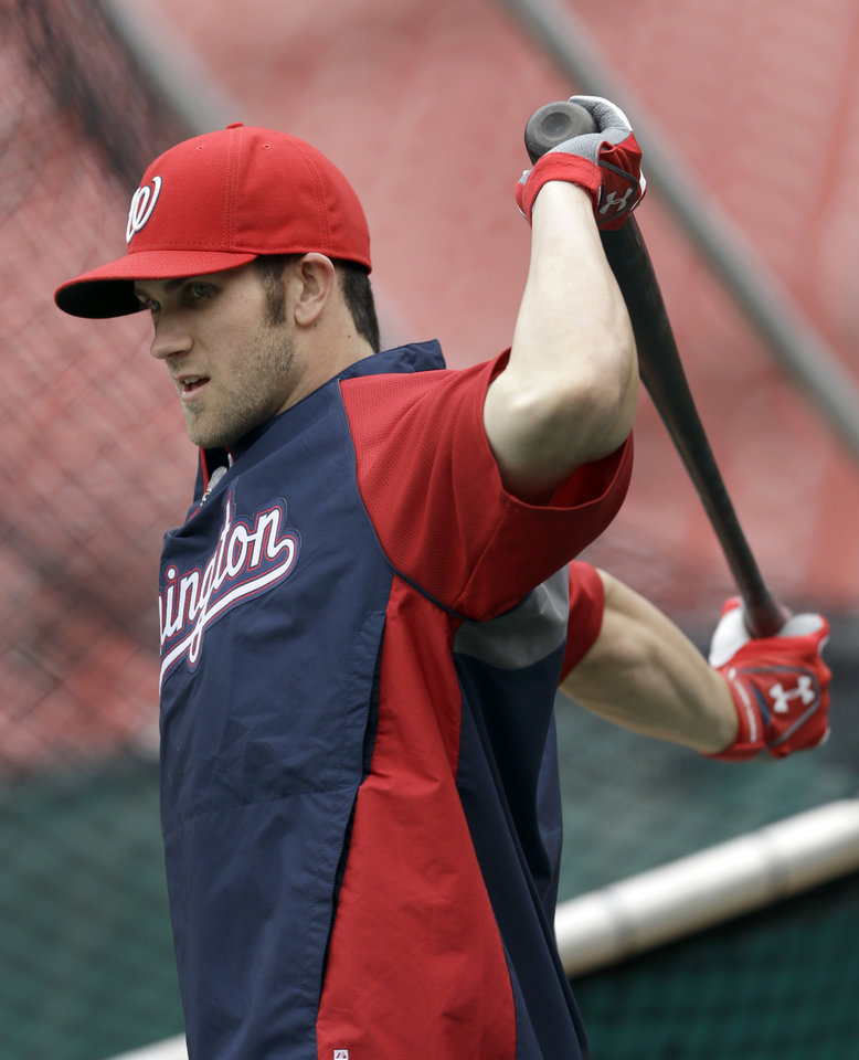 Washington Nationals' Bryce Harper prepares to step into the batting cage during baseball practice, Saturday, Oct. 6, 2012, in St. Louis. The Nationals and the St. Louis Cardinals are scheduled to play Game 1 in the National League division series on Sunday. (AP Photo/Jeff Roberson)