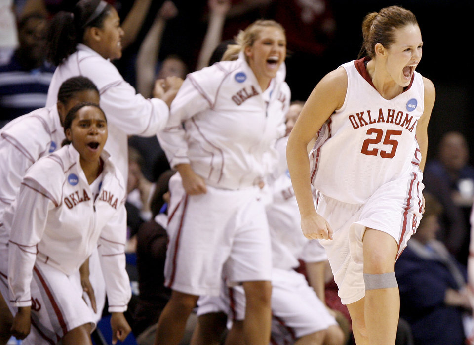 Photo - OU's Whitney Hand celebrates after a basket during the NCAA women's basketball regional  tournament finals between Oklahoma and Purdue at the Ford Center in Oklahoma City, Tuesday, March 31, 2009.  OU won, 74-68. Photo by Bryan Terry, The Oklahoman