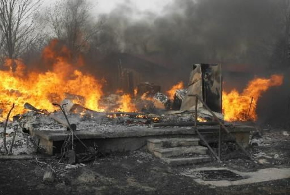 A burned home was in the path of wildfires which destroyed 12 structures in Lindsay, Okla. on Thursday, April 9, 2009. Photo by Steve Sisney