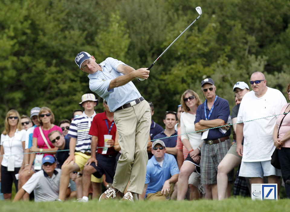 Photo - Jim Furyk hits off the third tee during the first round of the Deutsche Bank Championship golf tournament in Norton, Mass., Friday, Aug. 29, 2014. (AP Photo/Stew Milne)