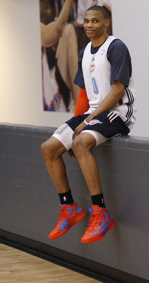 Photo -   Oklahoma City Thunder guard Russell Westbrook perches on a wall following a team practice in Oklahoma City, Monday, May 2, 2011. The Memphis Grizzlies face the Oklahoma City Thunder in Game 2 of a second-round NBA basketball playoff series in Oklahoma City on Tuesday. (AP Photo/Sue Ogrocki)