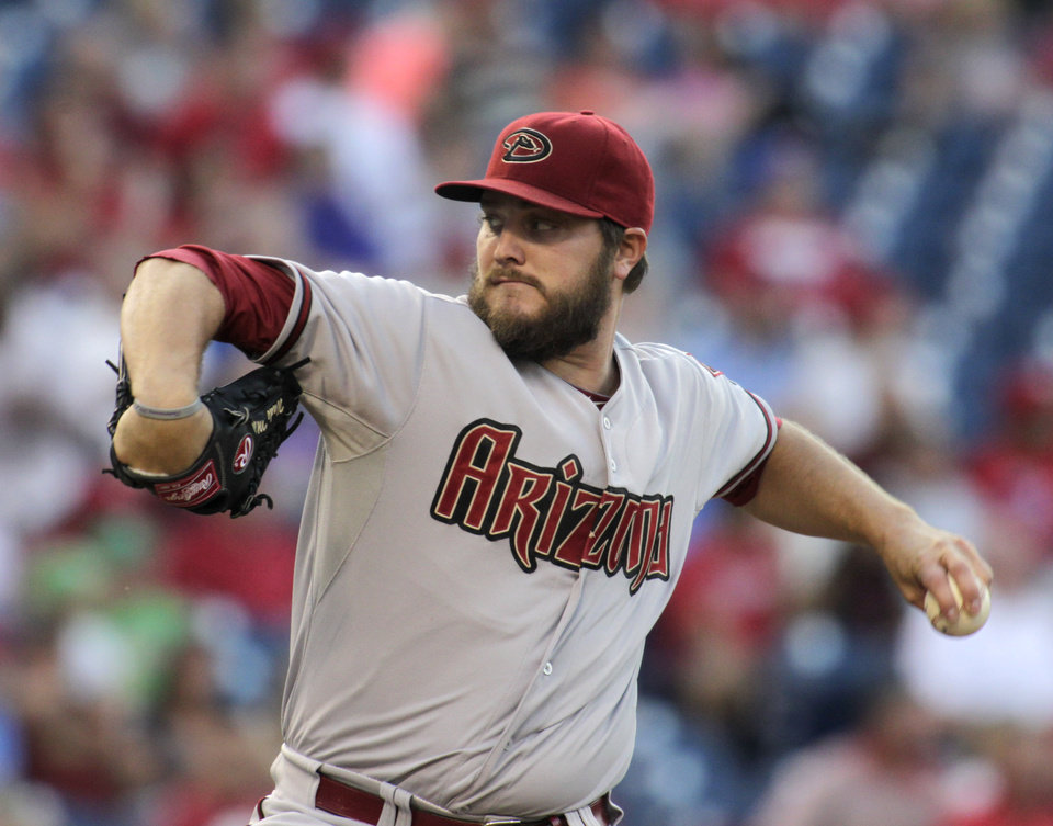 Photo - Arizona Diamondbacks starting pitcher Wade Miley throws against the Philadelphia Phillies in the first inning of a baseball game on Friday, July 25, 2014, in Philadelphia. (AP Photo/H. Rumph Jr)