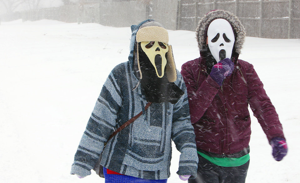 Photo - Long face. Two young ladies, walk to a friends house in Edmond using some masks to shield their faces from the stinging snow, Tuesday, February 1, 2011. Photo by David McDaniel, The Oklahoman
