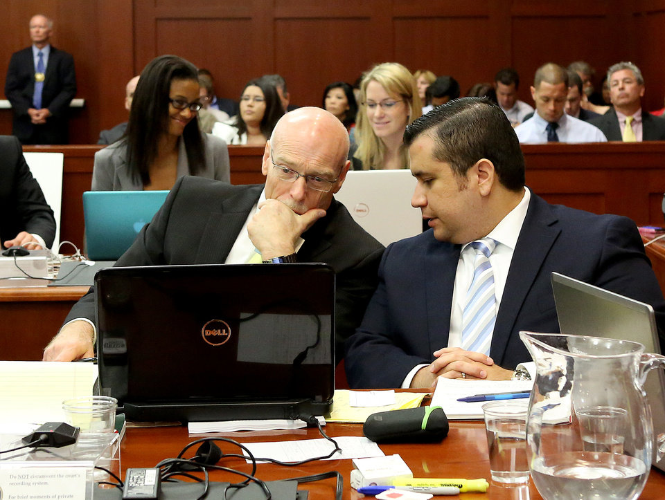 Photo - George Zimmerman, right, talks to attorney Don West during his trial in Seminole circuit court in Sanford, Fla. Wednesday, June 26, 2013. Zimmerman has been charged with second-degree murder for the 2012 shooting death of Trayvon Martin. (AP Photo/Orlando Sentinel, Jacob Langston, Pool)