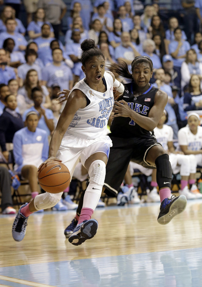Photo - FILE - In this March 2, 2014 photo, Duke's Elizabeth Williams, right, guards North Carolina's Diamond DeShields during the second half of an NCAA college women's basketball game in Chapel Hill, N.C. DeShields, the former North Carolina guard, is transferring to Tennessee, joining the school where her mother starred in a different sport. Tennessee announced Thursday, June 12, 2014, that the 2013-14 Atlantic Coast Conference freshman of the year would be continuing her career with the Lady Vols. DeShields' mother was an All-America heptathlete for the Tennessee women's track team in 1991, when she was known as Tisha Milligan. DeShields' father is Delino DeShields, a former second baseman who played for five major league teams from 1990-2002. (AP Photo/Gerry Broome, File)