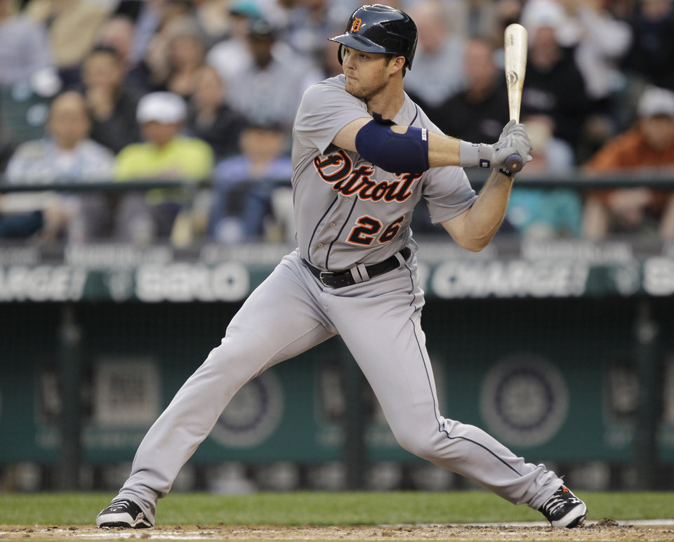Photo -   Detroit Tigers' Brennan Boesch starts his swing on an RBI single against the Seattle Mariners in the fourth inning of a baseball game, Monday, May 7, 2012, in Seattle. (AP Photo/Ted S. Warren)