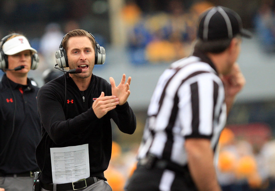 Photo - Texas Tech coach Kliff Kingsbury yells for timeout to an official during the second quarter of an NCAA college football game against West Virginia in Morgantown, W.Va., on Saturday, Oct. 19, 2013. Texas Tech won 37-27. (AP Photo/Chris Jackson)