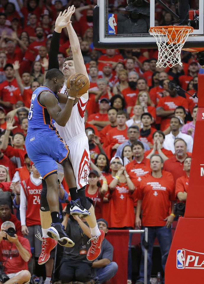 Oklahoma City's Reggie Jackson (15) attempts the last shot as Houston's Omer Asik (3) defends during Game 4 in the first round of the NBA playoffs between the Oklahoma City Thunder and the Houston Rockets at the Toyota Center in Houston, Texas,Sunday, April 29, 2013. Oklahoma City lost 105-103. Photo by Bryan Terry, The Oklahoman