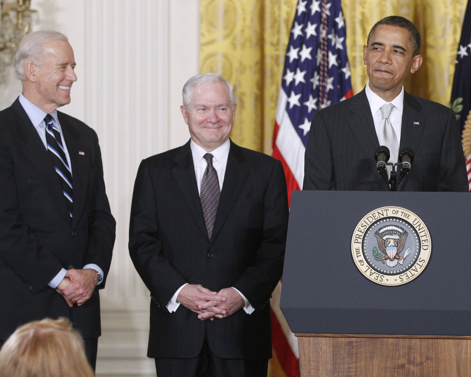 Photo - FILE - In this April 28. 2011 file photo, President Barack Obama stands in the East Room of the White House in Washington with, from left: Vice President Joe Biden and  outgoing Defense Secretary Robert Gates.  The White House is bristling over former Defense Secretary Robert Gates' new memoir accusing President Barack Obama of showing too little enthusiasm for the U.S. war mission in Afghanistan and sharply criticizing Vice President Joe Biden's foreign policy instincts.  (AP Photo/Charles Dharapak)