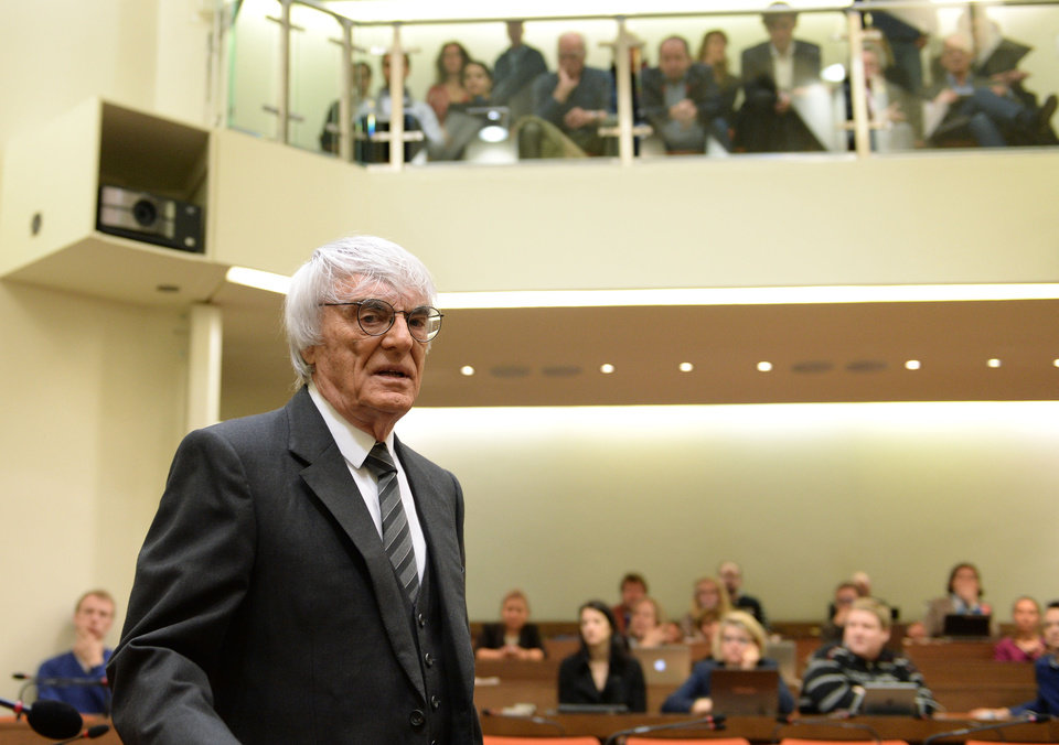 Photo - Formula One boss Bernie Ecclestone arrives for the fourth day of his trial at the courthouse in Munich, southern Germany, Tuesday, May 13, 2014. Ecclestone is charged with bribery and incitement to breach of trust